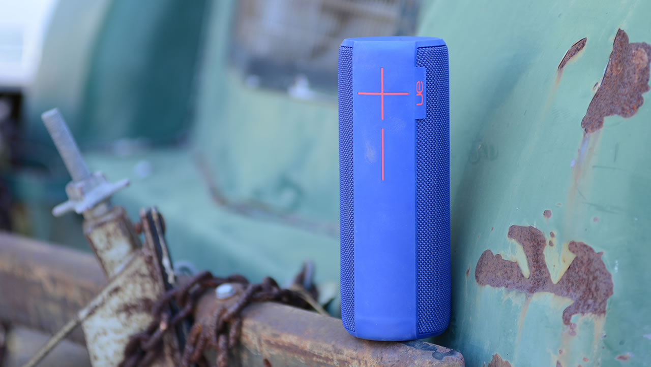 Blue UE Megaboom mobile speaker on a rusty bumper