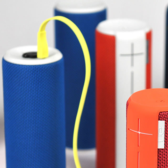 UE Boom portable speaker yellow charging cable