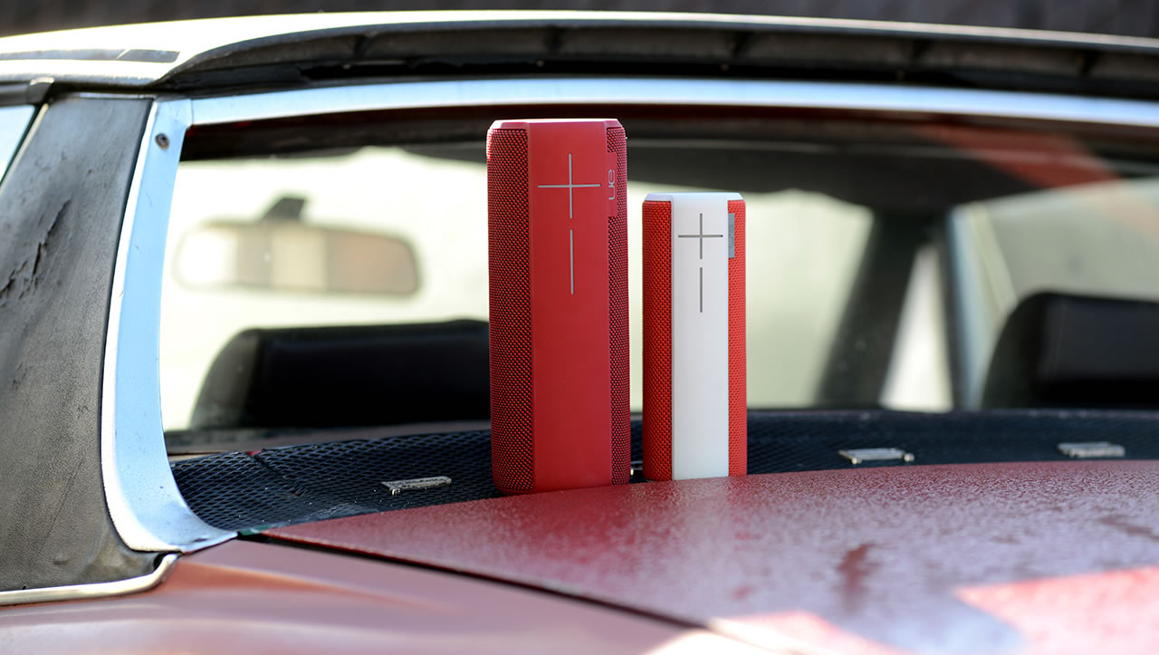 UE Boom and Megaboom mobile speakers on the car