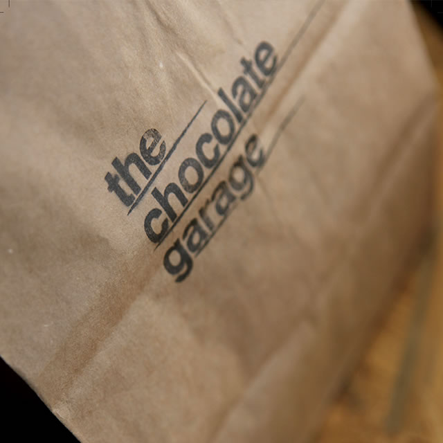 The Chocolate Garage logo on a bag