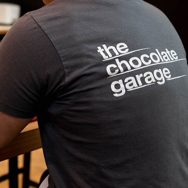 The Chocolate Garage logo on a t-shirt