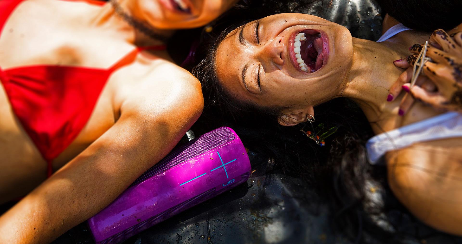 Purple water resistant UE Megaboom mobile speaker and laughing girls