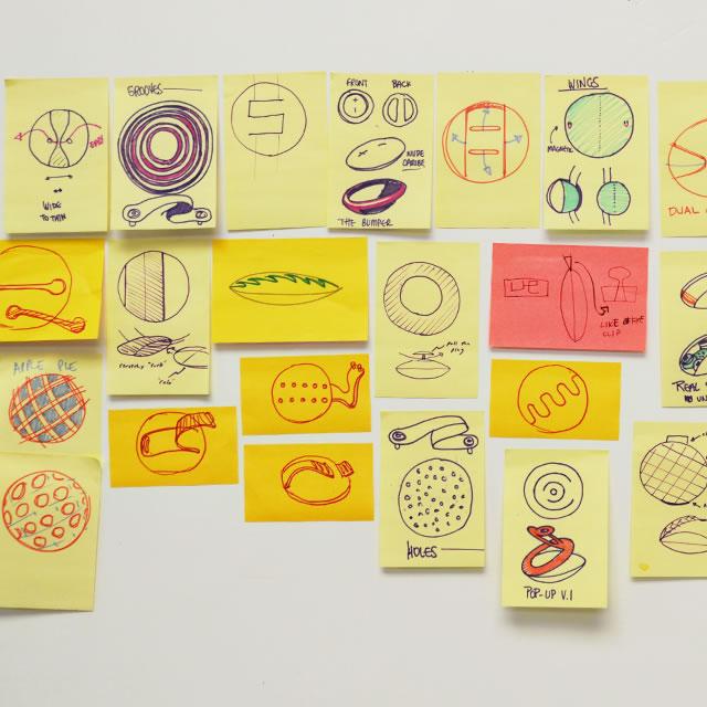UE Roll mobile speaker design sketches on postit notes
