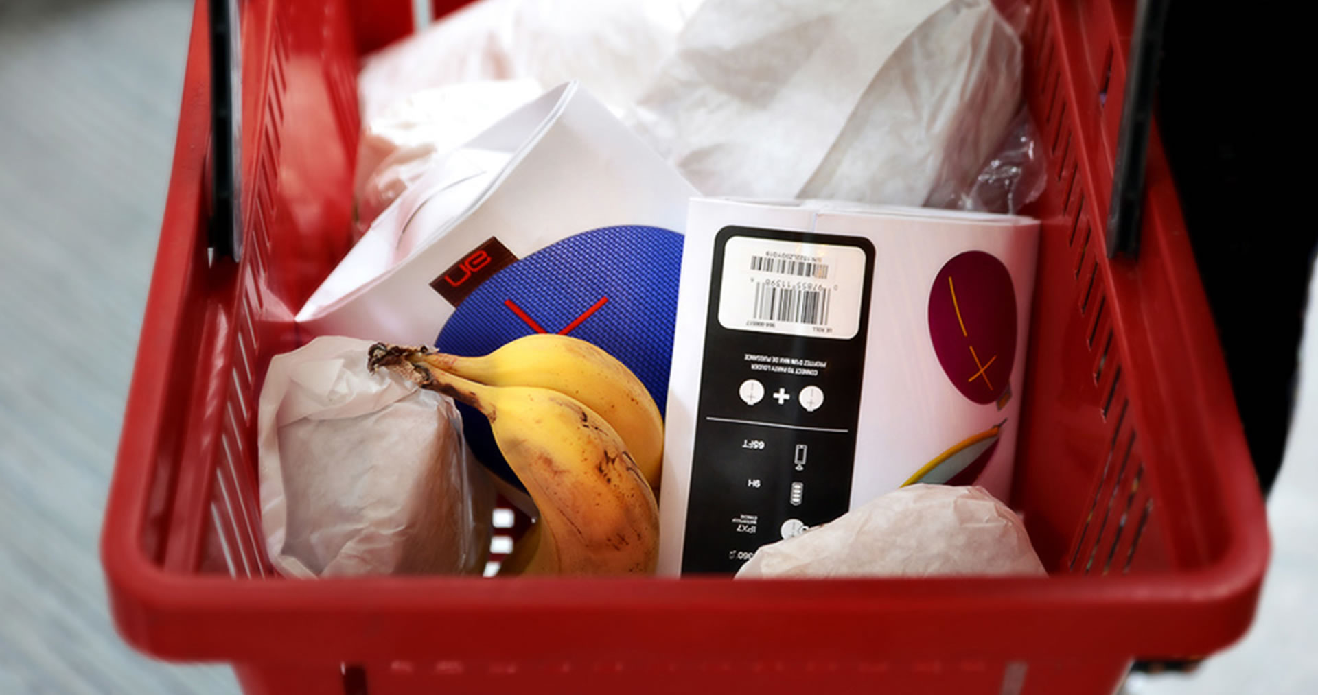 UE Roll portable speaker packaging in a shopping basket