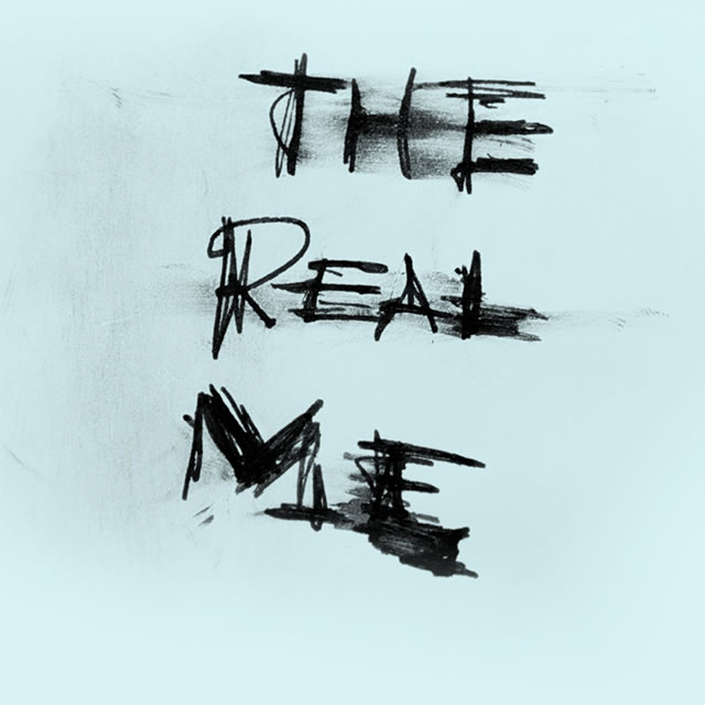 The Real Me scribble on UE Roll portable speaker packaging