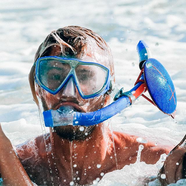 Waterproof Blue UE Roll mobile speaker on a snorkel