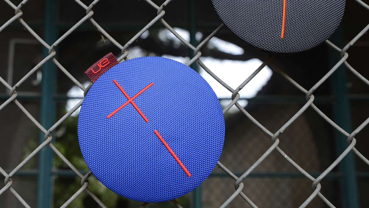 Blue UE Roll mobile speaker on a barbed wire fence