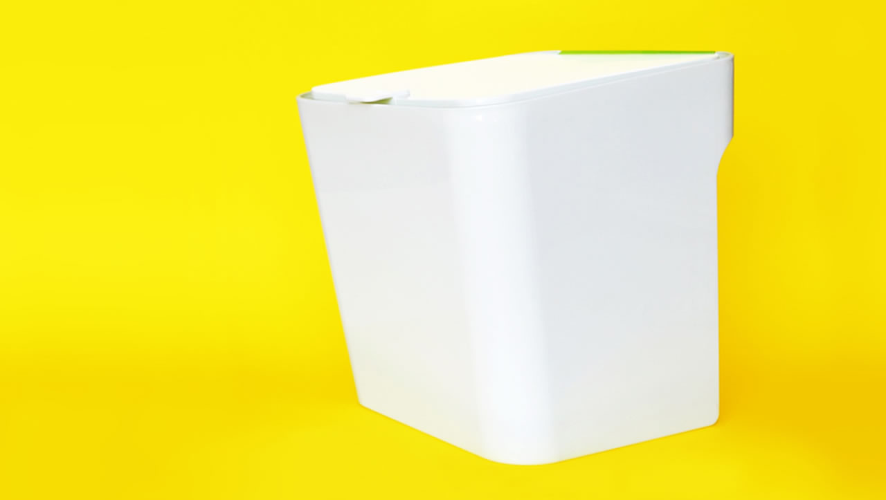 White Untrash composting can on yellow background
