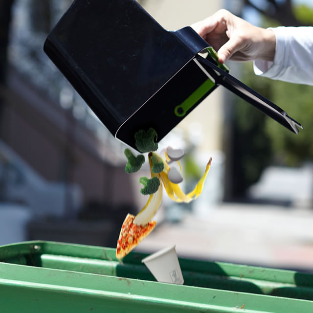 Black Untrash composting can emptying food scraps