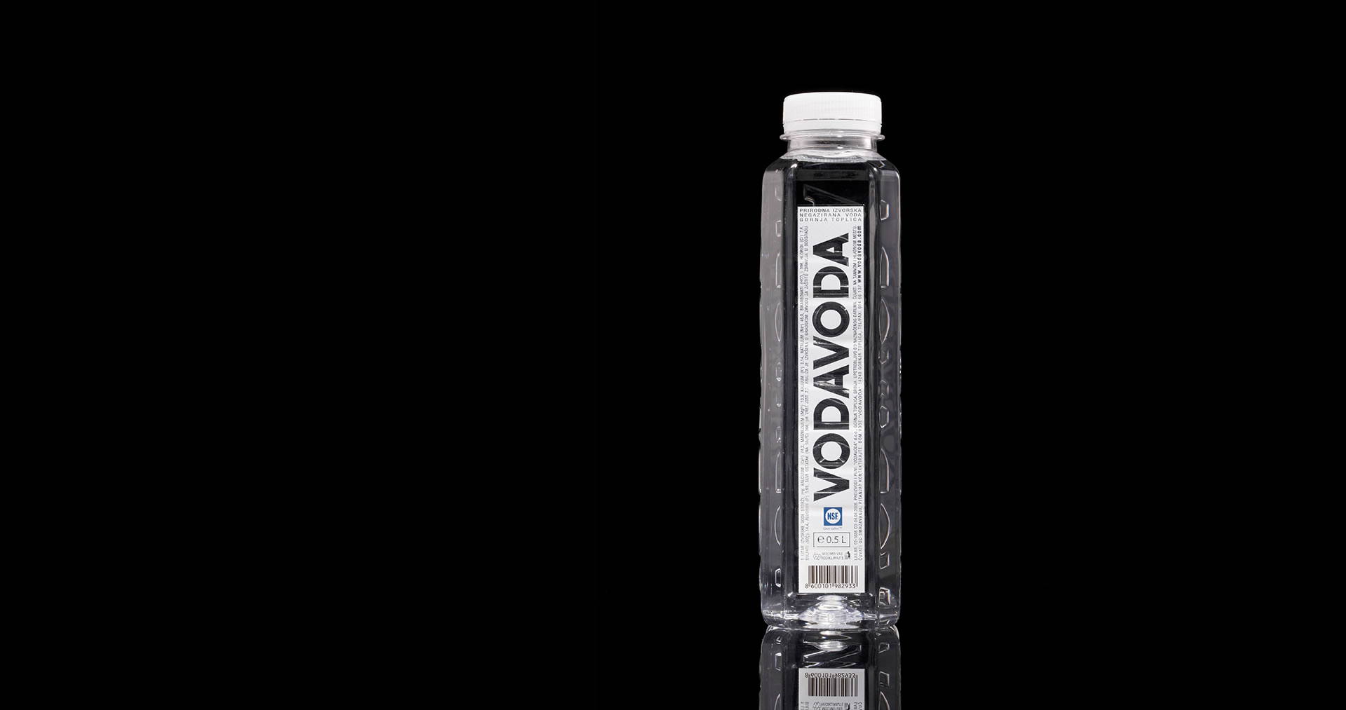 Vodavoda water bottle on black background